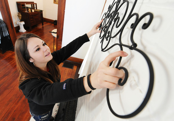Globe/T. Rob Brown<br /> Pittsburg State University SIFE (Students in Free Enterprise) member Kaitlin Bristley hangs decor Saturday morning, Feb. 23, 2013, at the Grace House event center in Galena, Kan. The house is owned by Richard and Kay Deardorff.