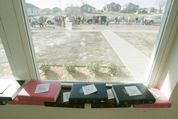 Globe/Roger Nomer<br /> Bibles to be given to Habitat families rest on a window sill before Tuesday's ceremony.