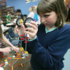 Globe/Roger Nomer<br /> Kerstin Riddle, fourth grade, examines her science project during class at Jasper Elementary on Thursday afternoon.