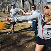 Globe/T. Rob Brown<br /> Marlana Bass, of Frontenac, Kan., launches her disc during a game of disc golf with fellow PSU students Ethan Bettes, left, of Lee's Summit, and Max Mancuso, of Overland Park, Kan., Monday afternoon, Feb. 4, 2013, at a public park in Pittsburg, Kan.