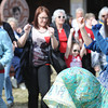 Globe/T. Rob Brown<br /> Shelli Jones of Joplin, right, leads a group of women in a dance for the international Million Women Rise event in front of the Joplin Public Library Thursday afternoon, Feb. 14, 2013.