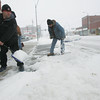 Globe/Roger Nomer<br /> Dustin Hartwick, left, and Perry St. Martin clear ice from the sidewalk in front of Souls Harbor on Thursday morning.