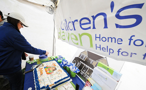 Globe/T. Rob Brown<br /> Liz Erickson, Children's Haven recovery funding & development coordinator, gets a plate for cake during the haven's 10th birthday celebration Thursday evening, Jan. 31, 2013, in a tent outside the home for children. The nonprofit haven, located at 701 S. Picher Ave., held a birthday party open to the public.