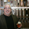 Globe/Roger Nomer<br /> Boulevard CEO Mike Magoulas poses by the taps at Blackthorn Pizza and Pub earlier this month.