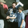 Globe/Roger Nomer<br /> Habitat Construction Manager Matt McGee gets a handshake from Christopher Goddard as thanks for helping build his family's new home.  Also pictured is Christopher's mother, Melissa Goddard.