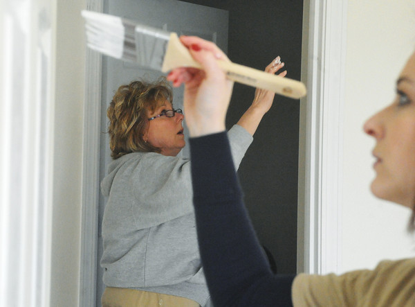 Globe/Roger Nomer<br /> Judge Gayle Crane, left, and Elizabeth Wiemelt touch up and paint trim at 2630 Wall during a recent work day.