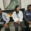 Globe/Roger Nomer<br /> (from left) Darron Claxton, a sophomore from Memphis, Tenn., Haley Blackwood, a freshman from Westville, Okla., and MarQuan Durant, a freshman from Tulsa, warm up by the fireplace at the NEO Student Union on a wintry Monday afternoon.