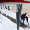 Globe/T. Rob Brown<br /> Bob Maus, a delivery driver for State Beauty Supply shovels ice and snow Thursday afternoon, Feb. 21, 2013, in front of the entrance to the business in the 500 block of South Virginia Avenue. Maus said it was his third time of cleaning the sidewalk off Thursday.