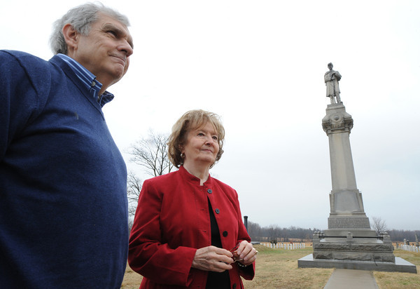 Globe/T. Rob Brown<br /> Larry O'Neal, historian and event co-chair, and Phyllis Abbott, curator, exhibit specialist and event co-chair, both with the Baxter Springs (Kan.) Heritage Center and Museum, smile outside a monument in honor of those who lost their lives during the Civil War massacre in Baxter Springs.