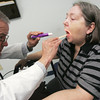 Globe/Roger Nomer<br /> Orville Mehaffy gives a check up to Patricia Bailey, Joplin, at Access Medical on Wednesday afternoon.