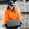 Globe/T. Rob Brown<br /> Michelle Million-Worley, of Poplar Bluff, carries in a cinder block as she volunteers with Samaritan's Purse Friday morning, Feb. 15, 2013, at a home in the 2500 block of South Virginia Avenue. She is volunteering in memory of her recently deceased daughter.