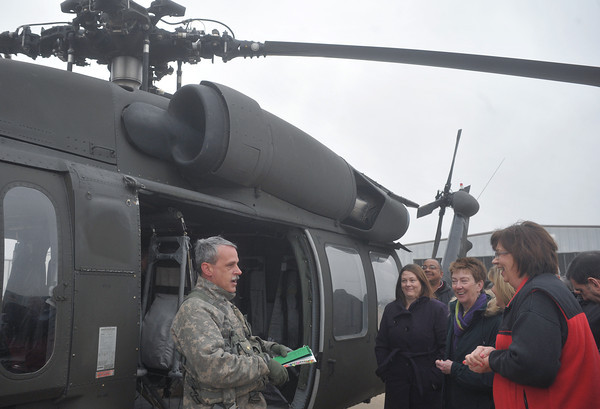 Globe/Roger Nomer<br /> First Sgt. John Lewis gives a briefing to city officials before an aerial tour of Joplin in Black Hawk helicopter on Wednesday morning.