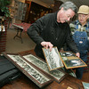 Globe/Roger Nomer<br /> Paul Wannemacher, left, and Billie Crawford look over photos from Crawford's mining days before an interview at the Dobson Museum on Monday.