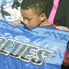 Globe/Roger Nomer<br /> Garren Berry, 7, plays with a St. Louis Blues flag on Tuesday afternoon.  Berry's house was built in cooperation with the Blues as part of the Governor's Challenge with Habitat.