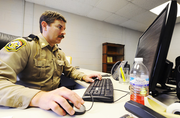 Globe/T. Rob Brown<br /> Jasper County Sheriff Randee Kaiser works on paperwork Wednesday afternoon, Feb. 6, 2013, at the department's headquarters near Duenweg.