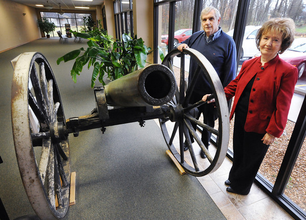 Globe/T. Rob Brown<br /> Larry O'Neal, historian and event co-chair, and Phyllis Abbott, curator, exhibit specialist and event co-chair, both with the Baxter Springs (Kan.) Heritage Center and Museum, stand next to a Civl War-era cannon at the museum.