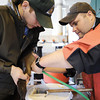 Globe/T. Rob Brown<br /> Step 10: Roaring River State Park Fish Hatchery resource assistants Cody Cantwell, left, and Dustin Back collect rainbow trout eggs after they have been inspected.