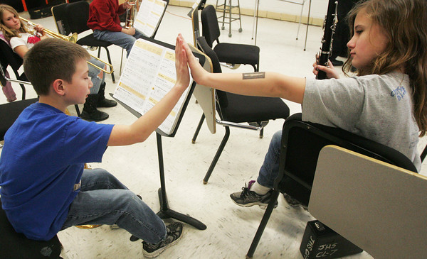 Globe/Roger Nomer<br /> Fifth-grader Isaac Winger shows relief as he gets a high five from Kathryn Smith after he passed a music test at Jasper Elementary on Thursday.