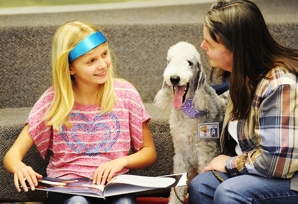 Globe/T. Rob Brown<br /> Khailynn Berliew, 10, of Carterville, asks a question of Debbie Miller about therapy dog Ricky, a Bedlington terrier, during the Dog Day Afternoon special program in the Storytime Room at the Joplin Public Library.