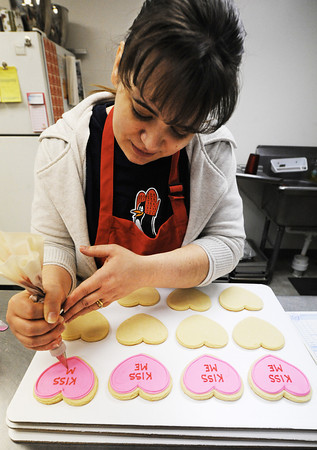 Globe/T. Rob Brown<br /> Lori Horton decorates heart-shaped cookies to look like candy hearts Tuesday morning, Feb. 12, 2013, at her downtown Pittsburg, Kan., bakery Celebrations by Lori, 602 N. Broadway.