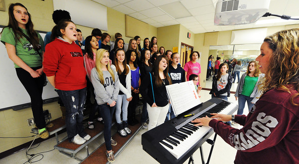 Globe/T. Rob Brown<br /> Karen Cameron, right, Joplin South Middle School choir teacher, leads one of three sections of seventh- and eighth-grade choir classes Thursday afternoon, Feb. 7, 2013, at the school's choir room.