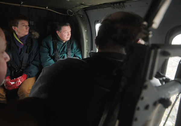 Globe/Roger Nomer<br /> Ann Bane, a specialist with the Joplin Legal Department, and Bruce Speck, Missouri Southern president, look over the tornado zone during a Black Hawk helicopter flight on Wednesday.