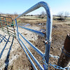 Globe/T. Rob Brown<br /> One of several gates Wednesday afternoon, Feb. 13, 2013, which were damaged by cattle rustlers recently when they stole most of a herd of cattle belonging to Kyle Burk of Marionville.