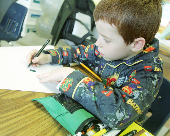 Globe/Roger Nomer<br /> Samuel Melton wore his Batman pajamas to class on Friday as part of themed dress-up day at Martin Luther School.  The school was celebrating National Lutheran Schools week.