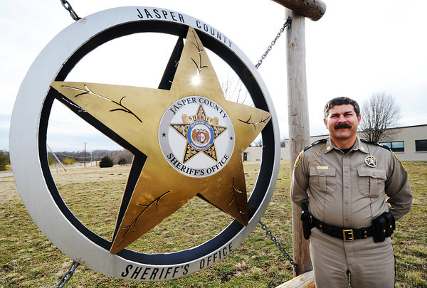 Globe/T. Rob Brown<br /> Jasper County Sheriff Randee Kaiser stands next to a monument sign Wednesday afternoon, Feb. 6, 2013, outside the department's headquarters near Duenweg.