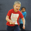 Globe/Roger Nomer<br /> Bradon Beerly, 6, lets out a yell before jumping during a game at the Boys and Girls Club on Monday.