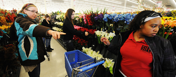 Globe/T. Rob Brown<br /> A group of Pittsburg State University SIFE (Students in Free Enterprise) members, from left, Lindsey Greve, Makayla Hamm, Kaitlin Bristley and Erica Jones look a section of artificial flowers for home decor during a shopping trip to Hobby Lobby Saturday morning, Feb. 23, 2013, in Joplin. PSU's SIFE has been helping the Grace House event center in Galena, Kan. The house is owned by Richard and Kay Deardorff.