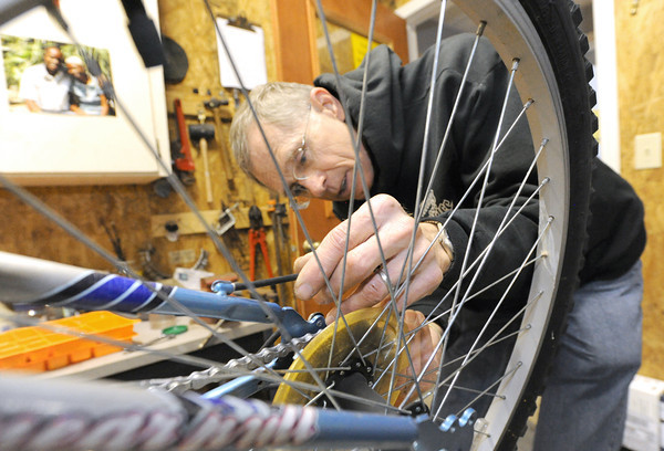 Don Smith fine tunes the shifting mechanism on one of the loaner bikes at Campus Christians in Pittsburg. The organization has loaned about 250 bikes this year to international students at Pittsburg State University.<br /> Globe | Laurie Sisk