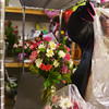 Globe/Roger Nomer<br /> Shelly Goerz puts protective plastic on an arrangement before delivery from Higdon Florists on Thursday.