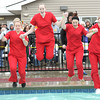 Representatives from  the Irene Ransom Bradley School of Nursing at Pittsburg State University prepare to hit the icy waters at Crimson Villa in Pittsburg on Saturday during the Polar Plunge to benefit Special Olympics. From the left : Samantha Rasdall, Paige LaBlank , Jordan Bain, Samantha Hlinicky  and Courtney Corder. More than $35,000 was raised from the plunge, a morning run and a chili feed. Organizers said 187 people took the plunge on Saturday.<br /> Globe | Laurie Sisk