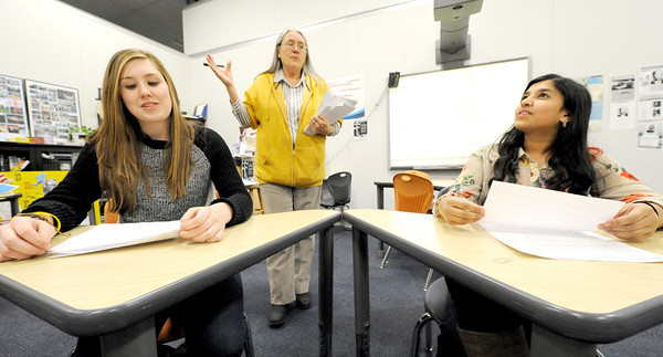 Joplin High School teacher Brenda White, center, offers tips for success while taking the ACT exams to JHS juniors Kate Salmon, left and Nazhath Sulthana during an ACT prep class on Friday at the school.<br /> Globe | Laurie Sisk