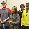 Globe/Roger Nomer<br /> Pittsburg State track atheltes (from left) Will Bruce, senior from Lee's Summit, D'Andria Blow, a sophomore from Grandview, Jasmine Smith, a freshman from Kansas City, Mo., and Henry Bell, a freshman from Overland Park, watch a video of the new Robert W. Plaster Indoor Event Center on Tuesday.