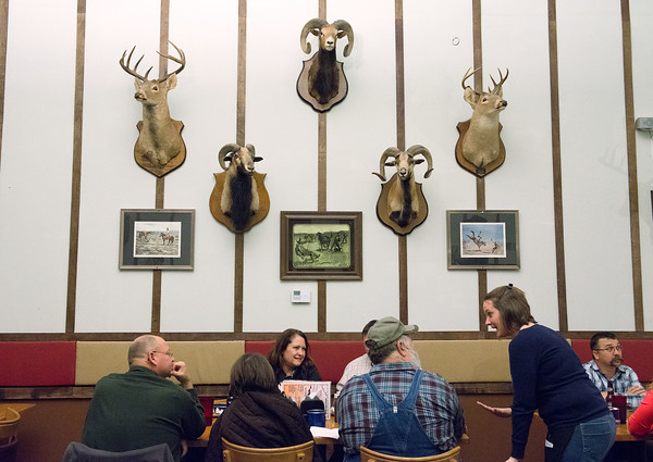 Globe/Roger Nomer<br /> Becky Peavler excitedly chats with a table of customers during a busy night at Cowboy Bob's on Feb. 15, 2014.