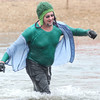 Keith Patterson, of Neosho, emerges from the 46-degree water of Shoal Creek with a smile during the Polar Plunge to benefit Special Olympics. This year was Patterson's thrid year to participate in the event.<br /> Globe | Laurie Sisk