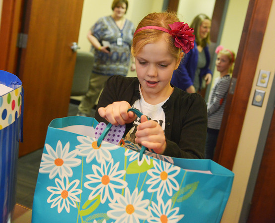 Globe/Roger Nomer<br /> Molly Waters, 10, brings in donations she received in lieu of birthday presents to the Via Christi Cancer Center on Friday morning.