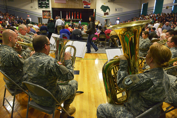 Globe/Roger Nomer<br /> The 135th Army Band from Springfield plays before the deployment ceremony for the 276th Engineer Company at Pierce City High School on Monday.