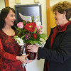 Globe/Roger Nomer<br /> Anita Massey, left, accepts delivery of flowers from Karen Eubanks at Eagle Picher on Thursday morning.