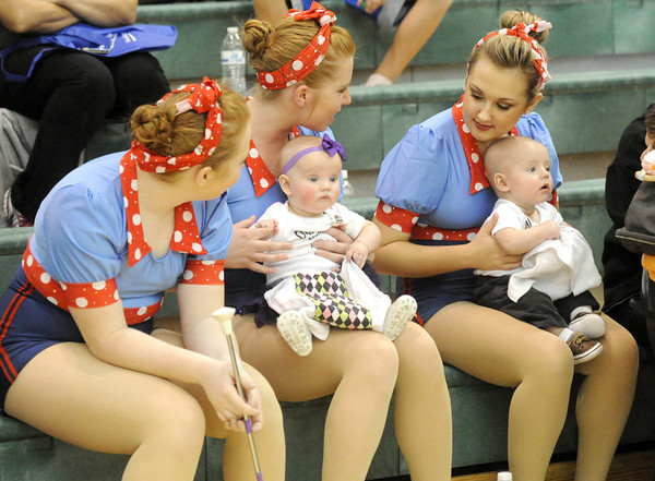 From the left: Mariah Donica, 14, Marisa Donica, 16 and Natalie Gilliam, 16, sit with six-month-old infants Jaclyn Friesen and Grady Friesen before the start of the Missouri Southern State University basketball game on Wednesday night at Leggett & Platt. The girls were waiting to perform at halftime with the Ovation sSudios Baton Twirling team from Carthage.<br /> Globe | Laurie Sisk