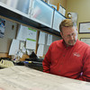Globe/Roger Nomer<br /> Carl Junction City Administrator Steve Lawver looks over plans in his office at city hall on Thursday.