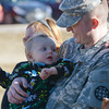 Globe/Roger Nomer<br /> Sgt. Aaron Duvel, Mt. Vernon, holds his nephew Benjamin Eakins, 1, following Monday's deployment ceremony.