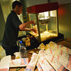 Globe/Roger Nomer<br /> Jake Benton, a Missouri Southern senior from Wentzville, makes popcorn for an Olympic watch party at Phelps Theater. On Wednesday morning, students gathered to watch the US Olympic hockey team take on the Czech Republic.