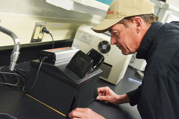 Globe/Roger Nomer<br /> Don Jackson, lead operator at Missouri American Water's treatment plant at 21st and Murphy, runs a test on drinking water on Tuesday.
