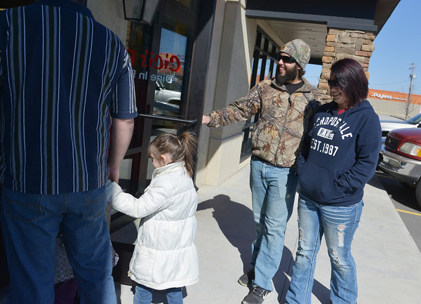 Globe/Roger Nomer<br /> Customers like Holly Curtis and Derrick O'Dell, Joplin, found a line out the door on Monday as CiCi's Pizza held their grand reopening in Joplin.