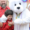 Luke Guss, 10, Nevada, gets a warm hug from a polar bear mascot on Saturday before braving the 46-degree waters of Shoal Creek during the Polar Plunge to benefit Special Olympics.<br /> Globe | Laurie Sisk