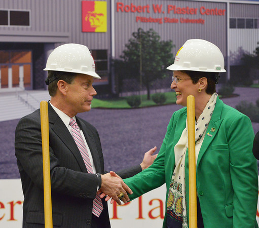 Globe/Roger Nomer<br /> Pittsburg State University President Steve Scott shakes hands with Dolly Clement, executive director of the Robert W. Plaster Foundation, following Tuesday's groundbreaking for the indoor event center named after Plaster.