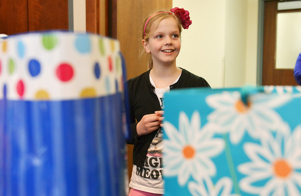 Globe/Roger Nomer<br /> Molly Waters, 10, talks about donations she received in lieu of birthday presents to the Via Christi Cancer Center on Friday morning.